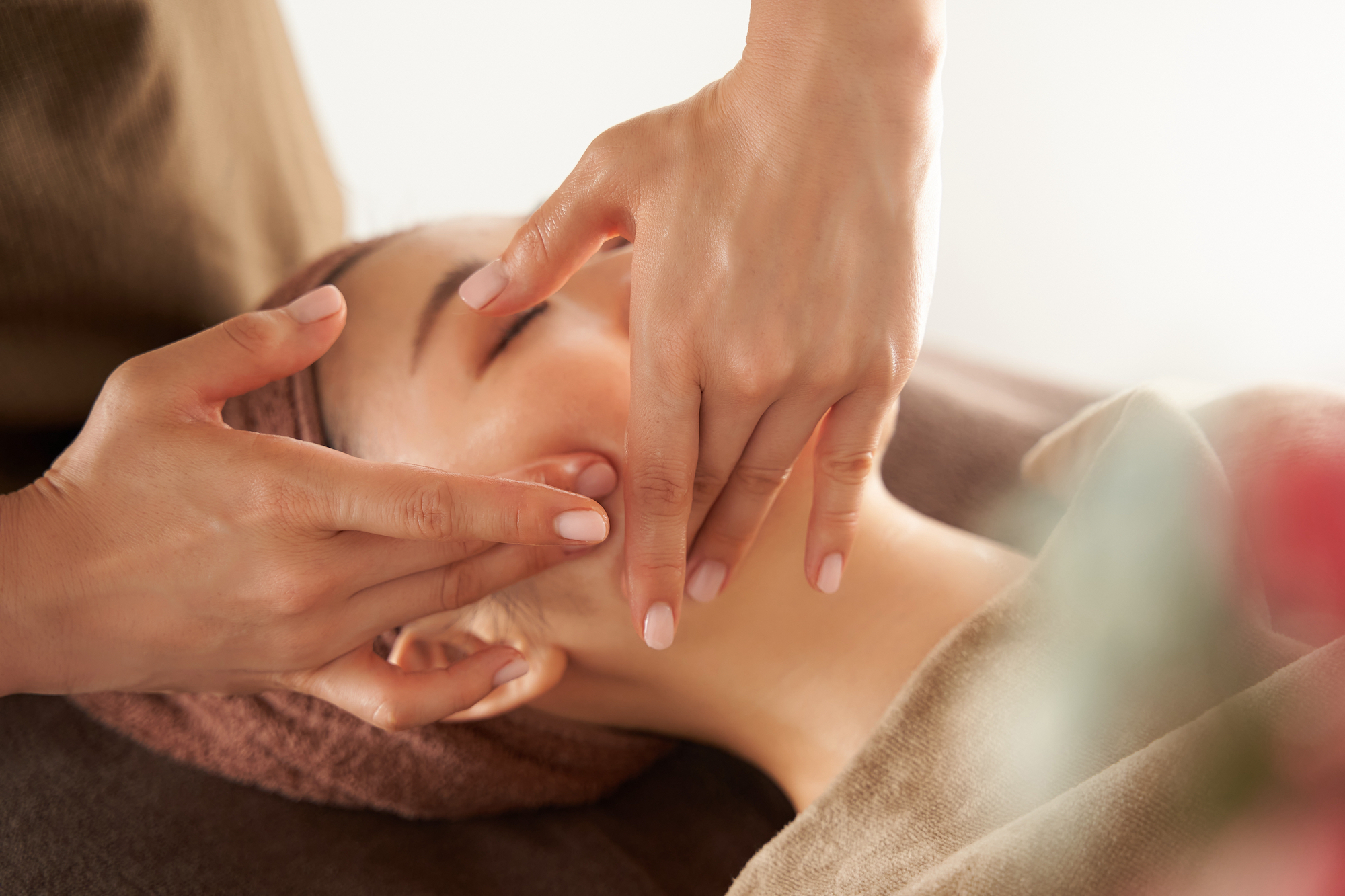 Woman getting her face massaged